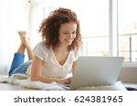 beautiful young woman using... | Shutterstock . vector #624381965