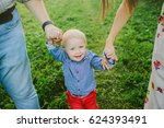happy family outdoors playing ... | Shutterstock . vector #624393491