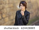 beautiful young woman smoking... | Shutterstock . vector #624428885