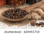 spice cloves in a wooden spoon...   Shutterstock . vector #624451715