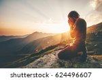 man praying at sunset mountains ... | Shutterstock . vector #624496607