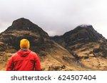 Man Walking In Mountains In...