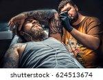 tattooer doing tattoo in tattoo ... | Shutterstock . vector #624513674