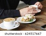 ginger cookies and man's hands... | Shutterstock . vector #624517667