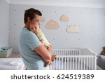 father comforting newborn baby... | Shutterstock . vector #624519389