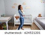Mother Comforting Newborn Baby...
