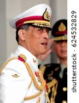 Small photo of File photo of Thai King Maha Vajiralongkorn Bodindradebayavarangkun smiles to people in Bangkok on May 5, 2010.