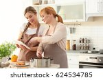 young woman and her mother... | Shutterstock . vector #624534785