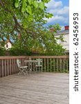 A Weathered Wood Deck With An...