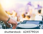 close up of dj's hand playing... | Shutterstock . vector #624579014