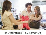 smiling couple buying clothes... | Shutterstock . vector #624590405