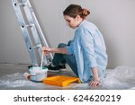 woman sitting on the floor and... | Shutterstock . vector #624620219