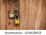 close up locked padlock on... | Shutterstock . vector #624628625