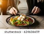 woman eating salad | Shutterstock . vector #624636659