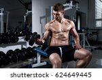 young man is training biceps... | Shutterstock . vector #624649445