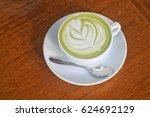 top view of hot matcha tea and...   Shutterstock . vector #624692129