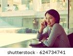 beautiful asian woman drinking...   Shutterstock . vector #624734741