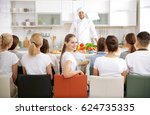 group of people at cooking... | Shutterstock . vector #624735335