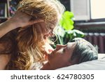 a man and a woman in sheets on...   Shutterstock . vector #624780305