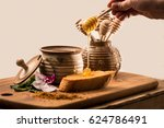 liquid honey and toast on a... | Shutterstock . vector #624786491