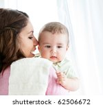 cheerful young mother taking... | Shutterstock . vector #62506672
