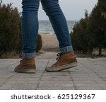 legs of a girl in brown... | Shutterstock . vector #625129367