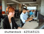 Small photo of Team of business people working in a call centre on the line.