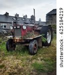 Old Rusty Red Tractor In...