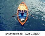 Young Man On A Boat   Rowing...