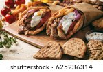 greek souvlaki  gyros wrapped... | Shutterstock . vector #625236314