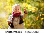 Beautiful outdoor autumn portrait of adorable toddler girl - stock photo
