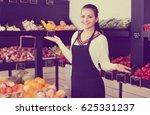 smiling female seller showing... | Shutterstock . vector #625331237