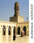 Small photo of Al-Hakim Mosque in Cairo with an unknown man from the back. It is a major Islamic site in Cairo, Egypt