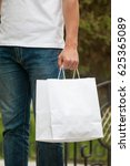 man with a white paper bag in... | Shutterstock . vector #625365089