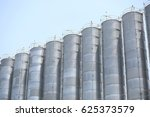 vertical chemical silos with sky | Shutterstock . vector #625373579