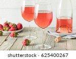 Stock photo refreshing pink ros wine in a glass 625400267