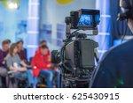 cameraman shooting in studio | Shutterstock . vector #625430915