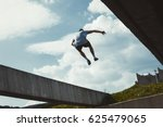 young man doing parkour jump in ... | Shutterstock . vector #625479065