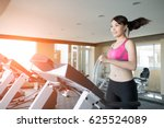 woman run on treadmill in the... | Shutterstock . vector #625524089