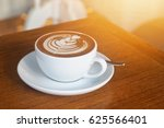 hot coffee and latte art in...   Shutterstock . vector #625566401