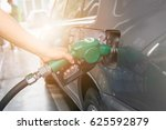 grey car at gas station being...   Shutterstock . vector #625592879