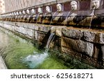 Small photo of Fountain of the 99 Spouts (Fontana delle 99 cannelle), Historic fountain with 99 jets distribuited along three walls, L Aquila, Italy