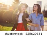 two girls walking with shopping ... | Shutterstock . vector #625620851