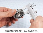 callipers with  bearing in hand ... | Shutterstock . vector #62568421