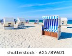 wicker chairs on white sand... | Shutterstock . vector #625789601