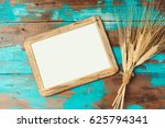 poster frame and wheat crop on... | Shutterstock . vector #625794341