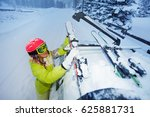 female skier fastening skis to... | Shutterstock . vector #625881731