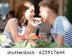 lovely couple eating pizza | Shutterstock . vector #625917644