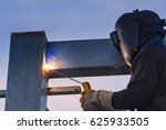 worker welding parts of stell... | Shutterstock . vector #625933505