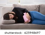 young woman lying on couch... | Shutterstock . vector #625948697